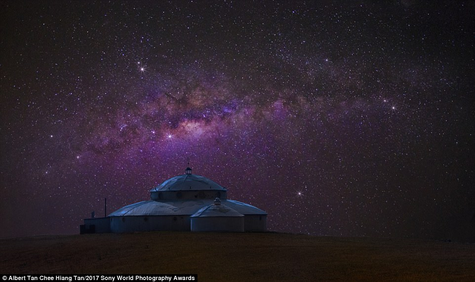 Heavenly campsite: The Milky Way hangs elegantly over a yurt in Inner Mongolia