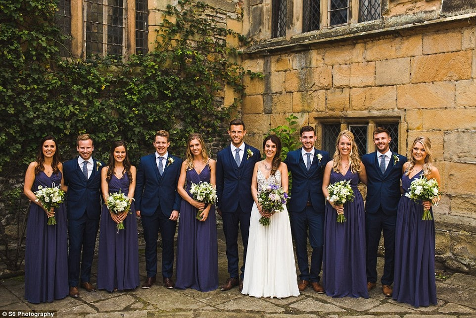 Ed and Heidi are pictured outside Haddon Hall with the wedding guests of honour, many of whom couple both knew at university