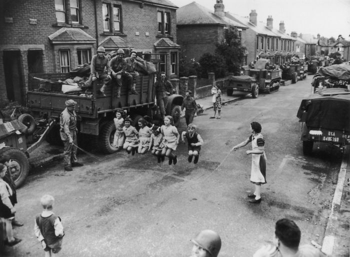 A Us Soldier Helps Some Children With Their Skipping, England, 1944