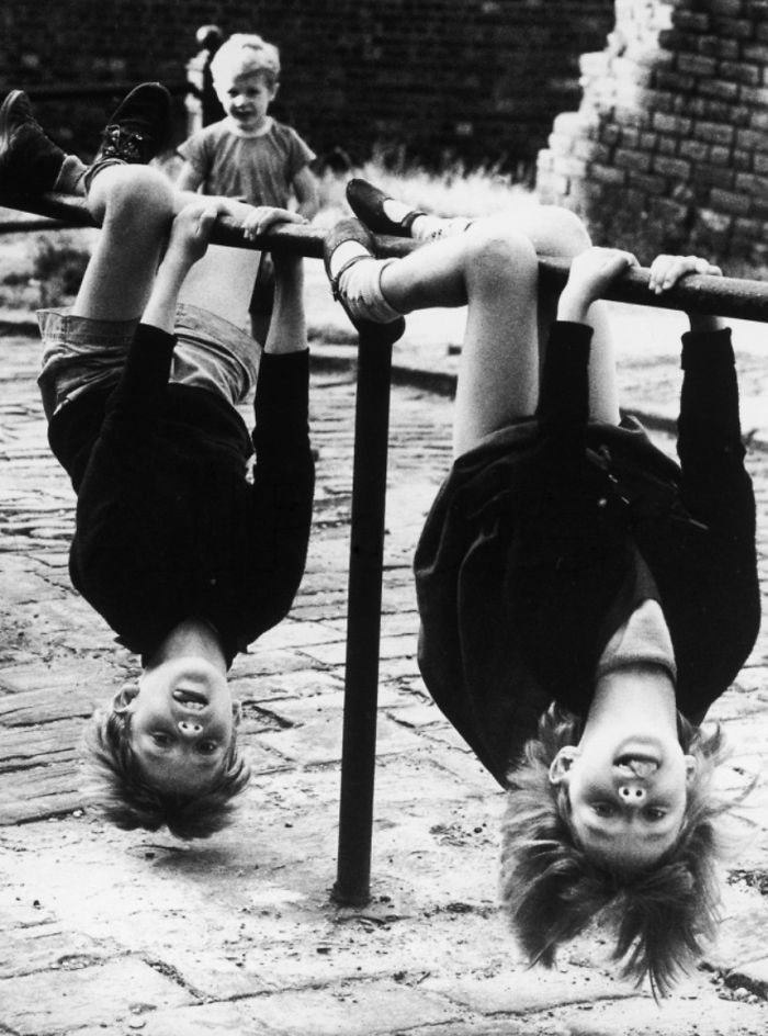 Two Children Have Great Fun Hanging Upside Down Off A Low Rail In Stockport, 1966