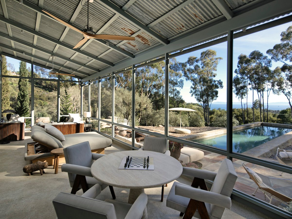 There is a sun room with a view across the pool and garden.