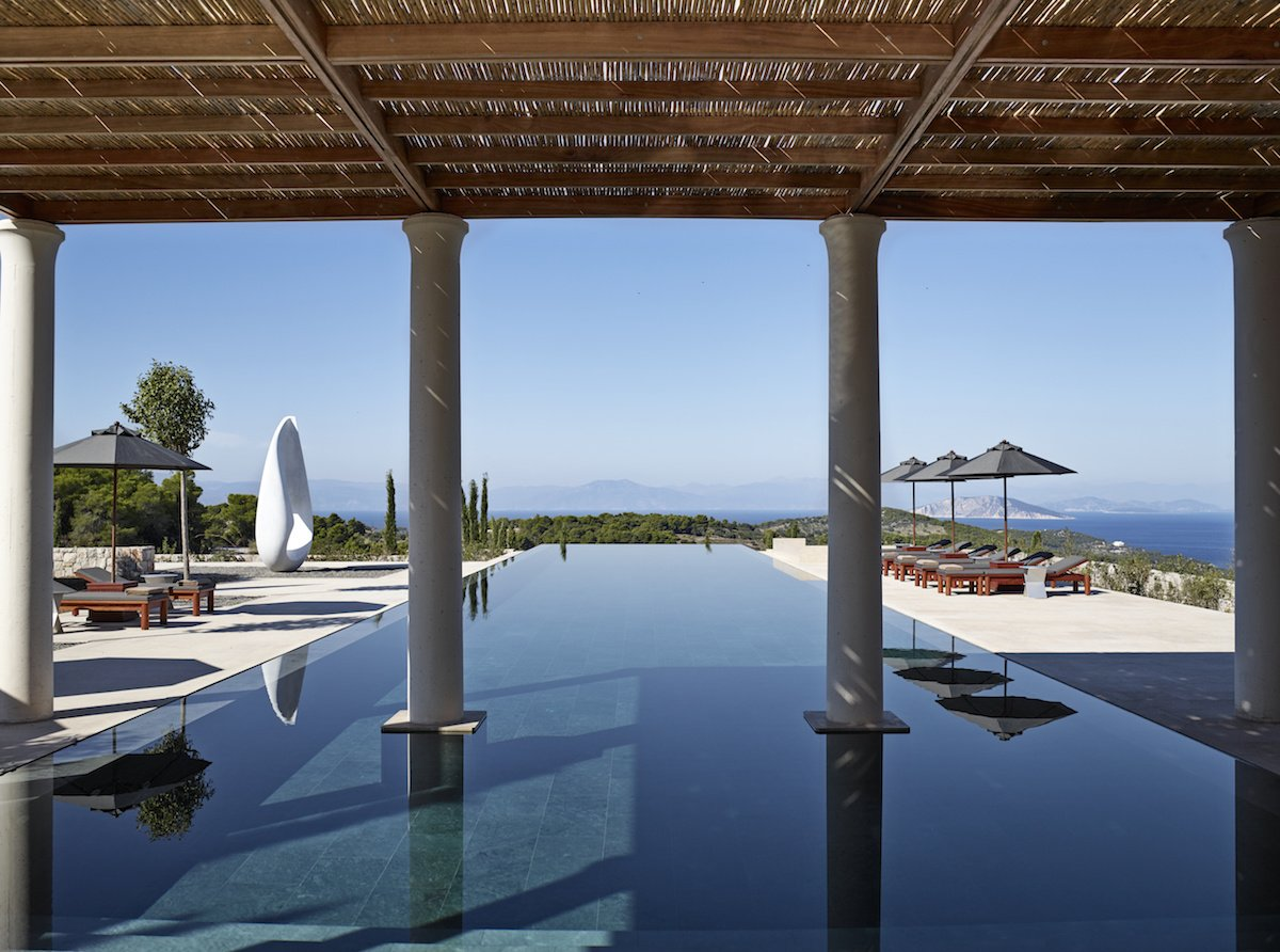 4. Amanzoe — Porto Heli, Greece. Situated on a hill surrounded by olive groves and lush fields, Amanzoe offers a slice of Greek paradise with outdoor kitchens and restaurants, infinity pools, and even its own private beach club.