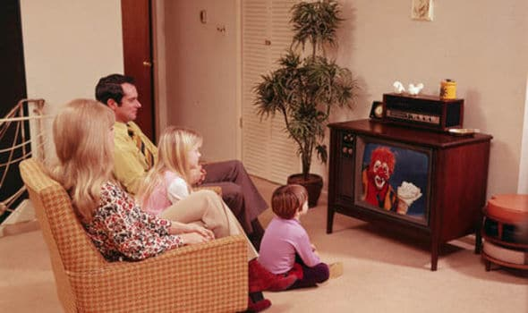 A family watching television in the 1970s