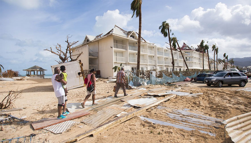 People Walk Through Damage In Marigot, St. Martin