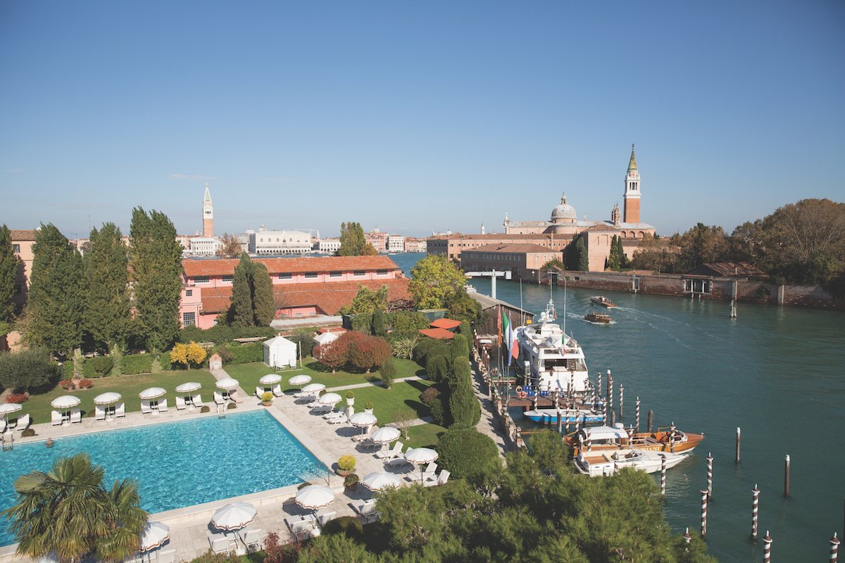 Only five minutes via private water taxi from the famous Piazza San Marco, the Belmond Cipriani is home to exclusive boutiques, a spa, and the only Olympic-sized swimming pool in central Venice, pictured here.