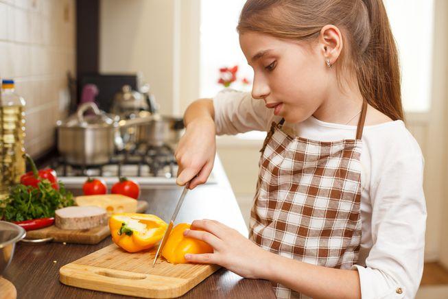 teen cutting pepper.jpg.653x0 q80 crop smart