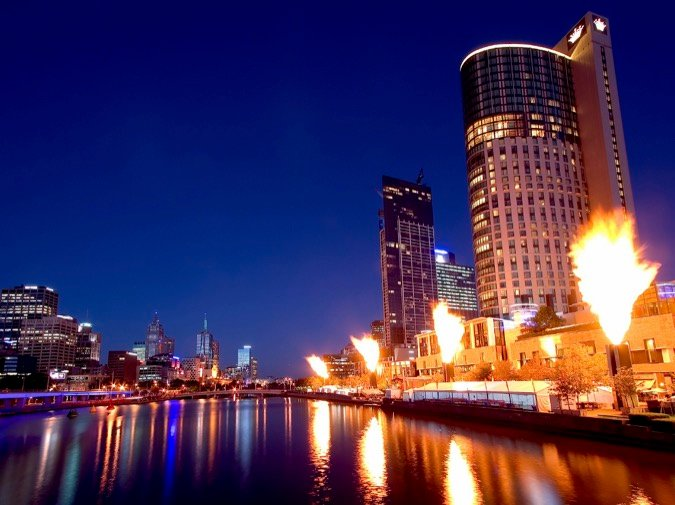 The Crown Casino fireshow, with the Melbourne skyline reflected off the Yarra river