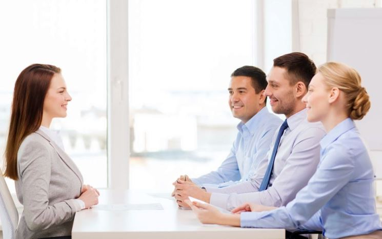 business, career and office concept - smiling businesswoman at job interview in office