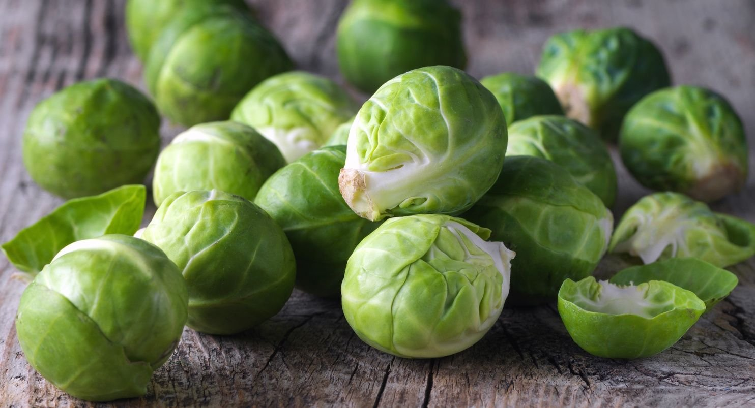 Brussels sprouts cabbage on old wooden table