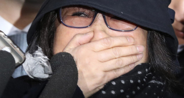 Choi Soon-sil, a cult leader's daughter with a decades-long connection to South Korean President Park Geun-hye, arrives at the Seoul Central District Prosecutors' Office in Seoul, South Korea, Monday, Oct. 31, 2016. The woman at the center of a scandal roiling South Korea met Monday with prosecutors examining whether she used her close ties to Park to pull government strings from the shadows and amass an illicit fortune. (Seo Myung-gon/Yonhap via AP)