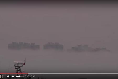 Ảo ảnh tòa nhà trên mây tại Đại Liên, Trung Quốc (Ảnh chụp từ Youtube).