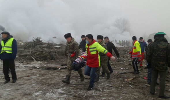 Rescue-workers-carry-a-victim-from-the-crash-site-790624