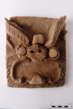 Phù điêu rồngrồng theo phong cách Trung Hoa, tìm thấy ở Por-Bajin năm 2007 (ảnh: Wiki)